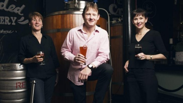 Redoak brewer David Hollyoak with sisters Janet and Helen at their pub in Sydney's CBD.