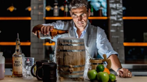 Grant Collins of Powder Keg on Kellet Street in Potts Point, makes the signature punch, served in a powder keg and aptly ...