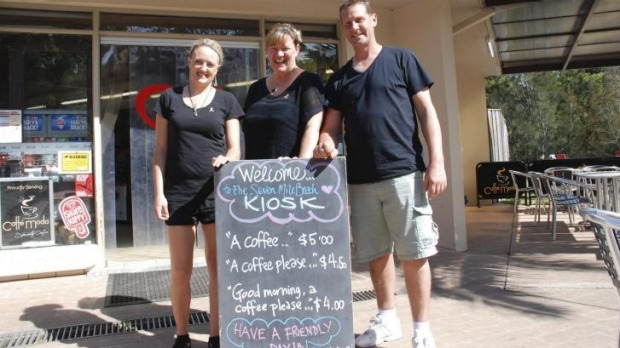 Head chef Megan Jones and owners Kylie Pickett and Kev Chilver with the sign.