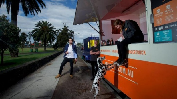 Jack White, The Brulee Cart owner (left) and Riley Woosnam and Maddison Chadderton of Mr Burger in Yarraville Gardens.