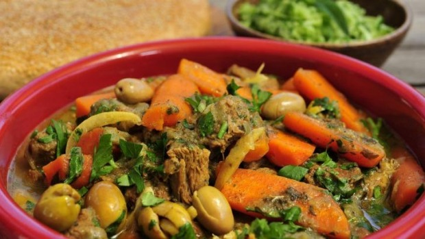 Easy and delicious: Moroccan lamb tagine with carrots, preserved lemons and olives with Moroccan semolina bread (Khobz ...
