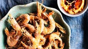 Crispy school prawns with harissa mayonnaise.