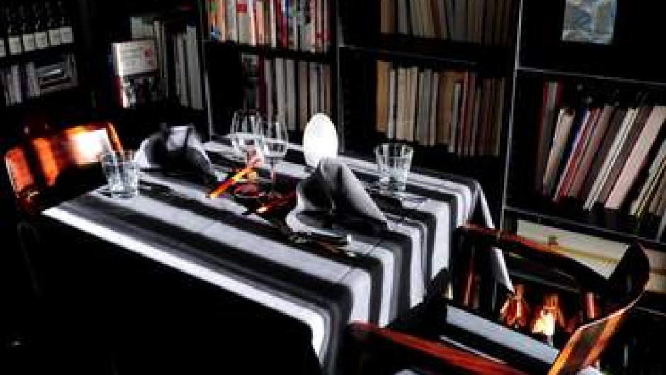 Inside Malamay's dark, formal dining room.