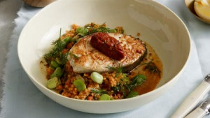 Seared fish cutlet with broad bean and fregola stew.