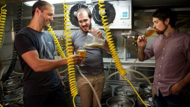 Fizzing: Scientists and amateur beer brewers Scott Brownless, centre, and Chad Husko, right, sample one of their ...