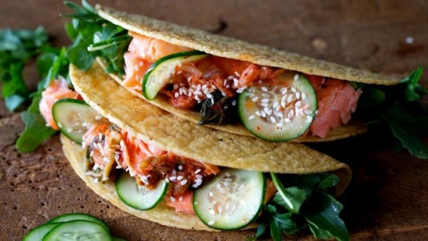 Cuisine mash-up in a hot, crunchy shell: Salmon and kimchi tacos.