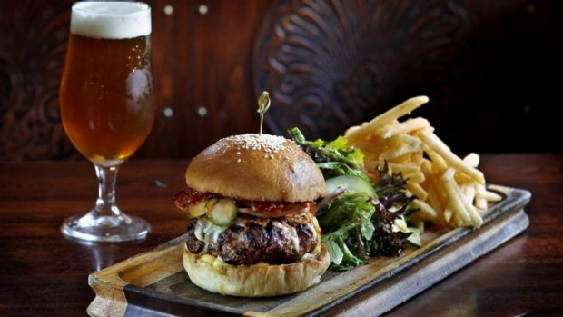 The classic combo of pub burger and beer at the East Village Hotel in Balmain.