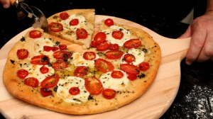 Cherry tomato with mozzarella and thyme pizza.