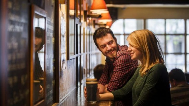 Good taste: Andrew  Deakins and Anna Trundle from Turner enjoy a stout at the Wig and Pen at Alinga Street before it ...
