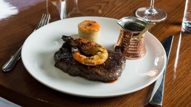 Dry-aged porterhouse with Mooloolaba prawn and potato gratin.