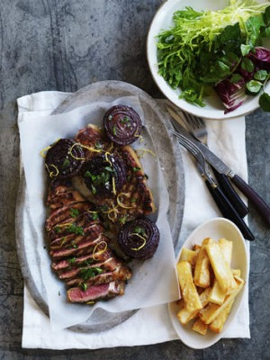 Neil Perry's barbecued beef sirloin with onion, parsley and lemon salad.