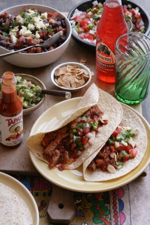 Soft tacos with smoky shredded pork.