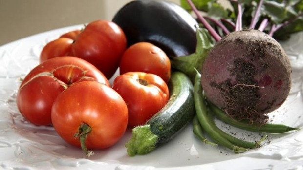 Vege feast: Some of Jennifer Yeats' of Yarralumla harvest including tomatoes, eggplant, zucchini and beetroot grown in ...