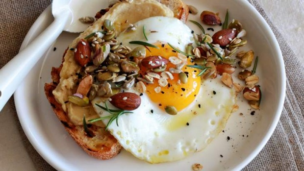 Crunch 'n' fibre: Scatter savoury granola over egg, toast and hommous.