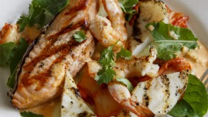 Barbecued seafood with cucumber and kimchi salad.