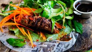 Grilled lemongrass beef rice-paper rolls.