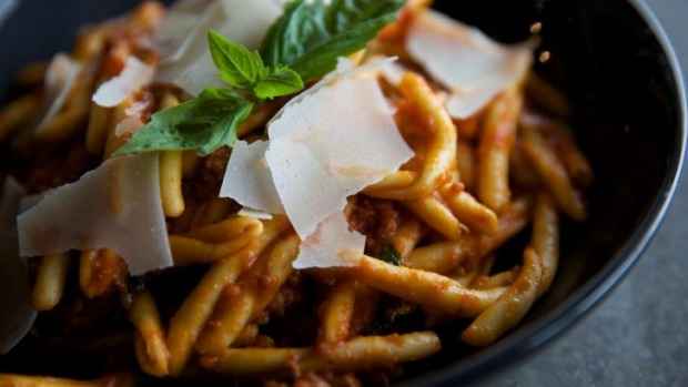 Twists of trofie pasta in tomato sugo.