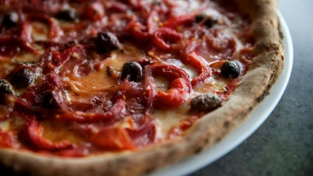 Thin and crisp: The diavola pizza with mozzarella fiordilatte, salami, capsicum and olives.