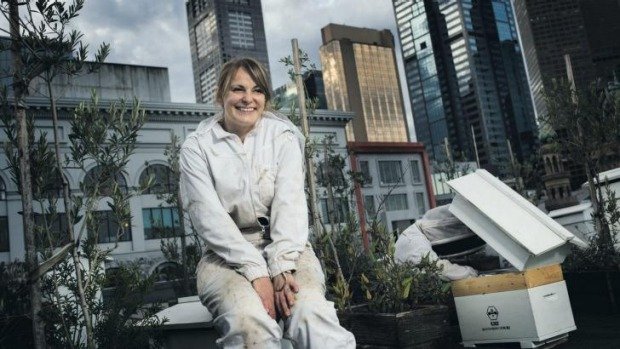 Vanessa Kwiatkowski and Mat Lumalasi with their hives on top of Federation Square.
