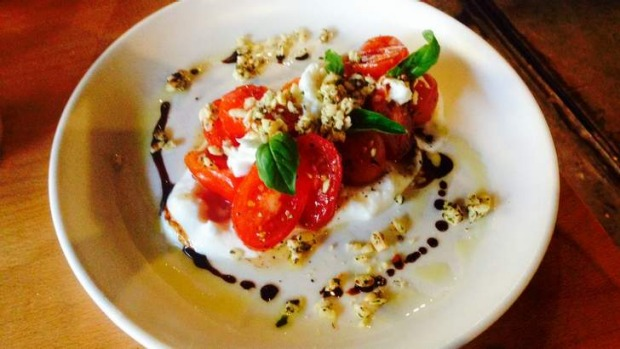 Baby tomatoes and mozzarella with granola and balsamic.