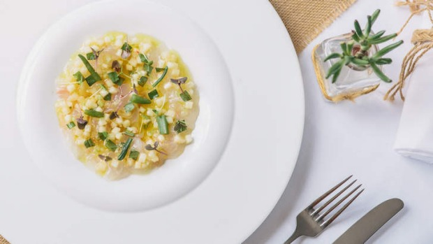 Go-to dish: Snapper carpaccio, white peach sauce vierge, basil and finger lime.