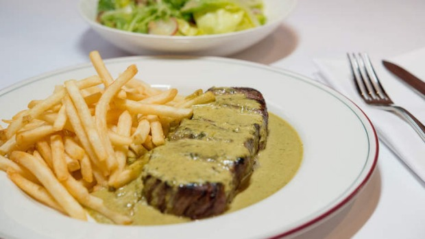 Signature dish: Steak, green salad with dijon vinaigrette and bottomless fries.