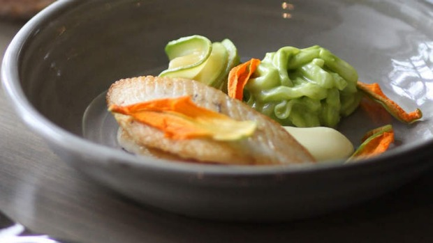 Of the sea: john dory fillets with squid noodles, zucchini flowers and spicy fish broth.