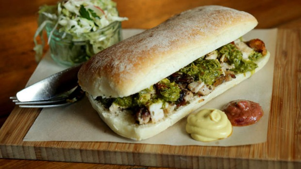 Porchetta sandwich with a side of slaw.