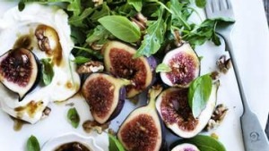 Salad of fresh figs with walnuts, goat's curd and pomegranate vinaigrette.