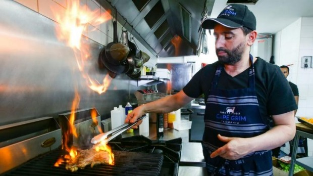 Peter Zaidan cooking at his business in Bondi.