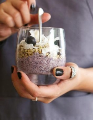 Chia pudding with almond milk, granola, blueberries and coconut.