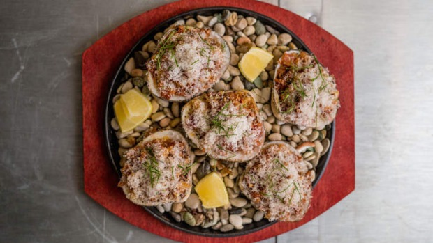Cloudy Bay clams served on baked stones.