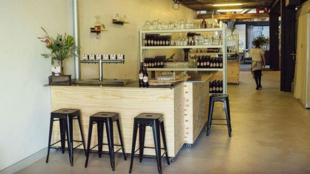The bar area featuring six kombucha taps.