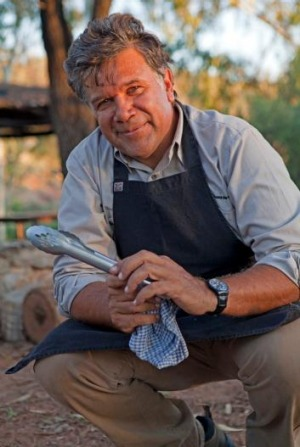 Bob Taylor at work in his open desert kitchen in Alice Springs.