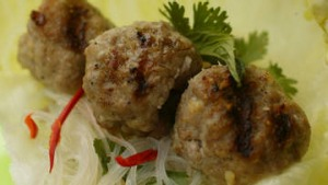 Pork balls with coriander and lettuce.