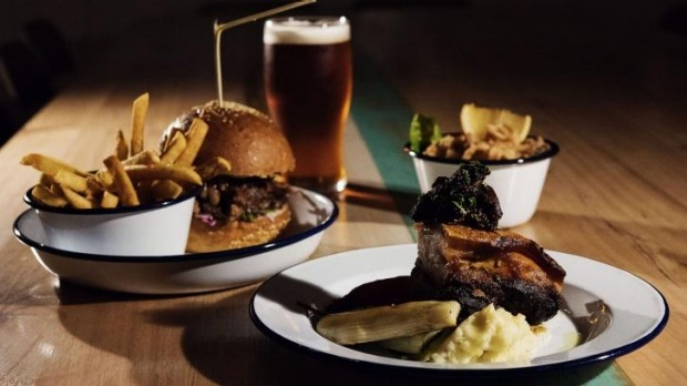 Relaxed fare: A pulled pork burger, fried baby squid and spiced pork belly at The Public in Cammeray.