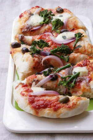 Pizza with broccolini, mozzarella and anchovy.