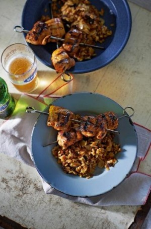 Chicken kebabs with prune orzo pilaf.