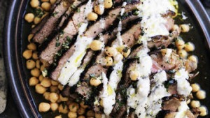 Neil Perry's marinated lamb leg with chickpea salad and garlic yoghurt dressing.