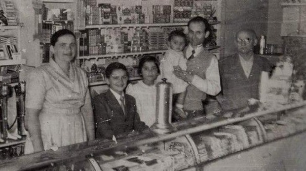 George Poulos with his family behind the counter of The Rio in its golden years. From left, Stavroula, Nik, Aphrodite, ...