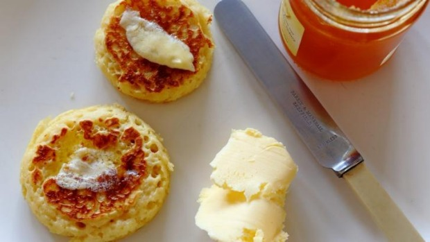 Golden and yeasty: Crumpets and honey.