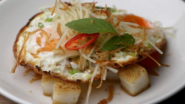 Rice cakes with fried egg, green papaya and chilli soy.