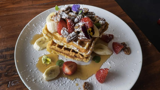 The waffle stack scattered with candied pecans.