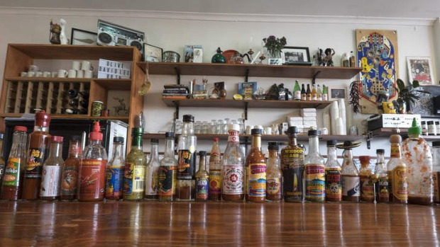 Rock 'n' roll: A line-up of hot sauces along the bar.