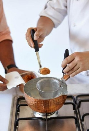Dissolve the miso through a sieve or in the base of a ladle to remove any pieces of husk or uncrushed grain.