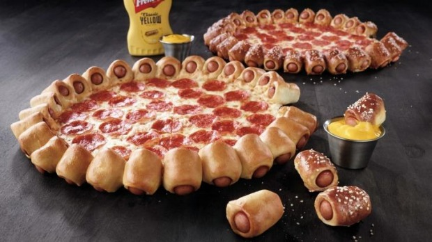 """Stuffed-crust behemoth: The new pizza features 28 """"premium hot dog bites"""" baked into the crust."""
