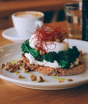 Poached eggs, broccolini, goat's curd and chilli 'hair' on toast.