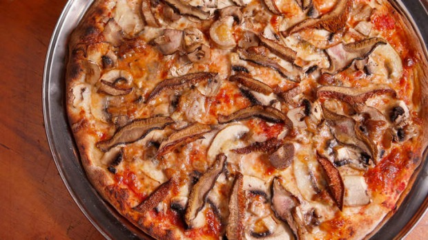 A fungi-scattered  pizza special.
