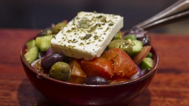 A classic Greek salad with a big sheet of salty feta.