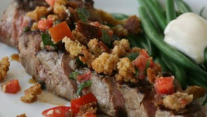 Chargrilled sirloin with crumbed bread, tomato and green beans.